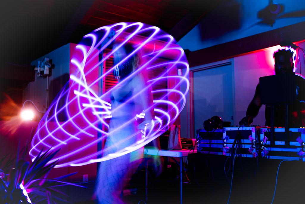 Light trails around hula hooper