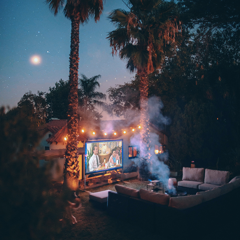 Outdoor Movie Screen with Palm Trees